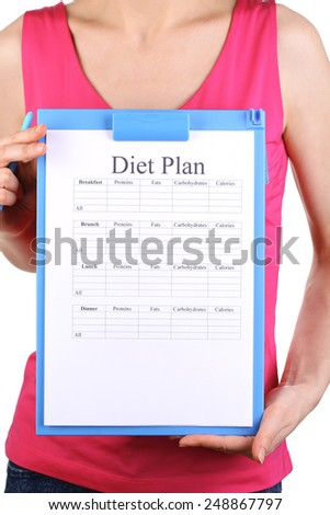 Sports trainer with diet program isolated on white - stock photo
