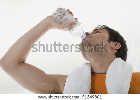 Sportsman drinking water - stock photo