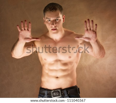 Sportsman isolated on brown - stock photo