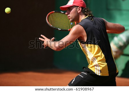 Sportsman plays tennis - stock photo