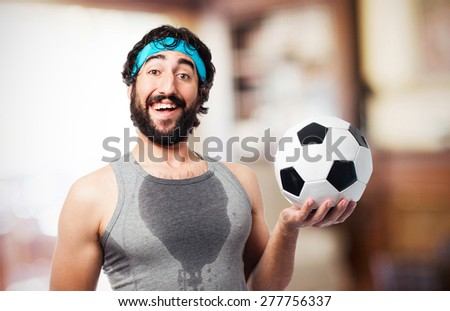 sportsman with football ball - stock photo