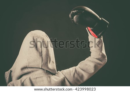 Sportsmanship and strong body. Win fight with opponent. Young woman wear hoodie victory pose show emotion with arm in air. Girl wear boxing gloves. - stock photo
