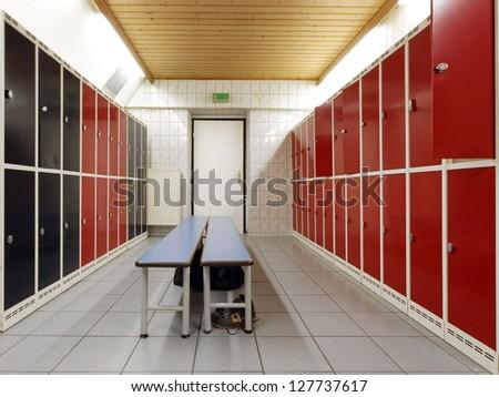 Sportsmen locker room with bench - stock photo