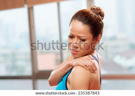 Sportswoman having pain in her back - stock photo