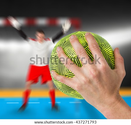Sportswoman holding a ball against digital image of handball goal - stock photo