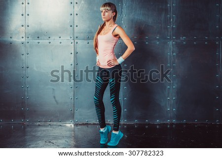 Sportswoman showing perfect female body in sports clothing sportswear concept sport healthy lifestyle - stock photo