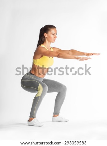 sportswoman squating isolated on white background - stock photo