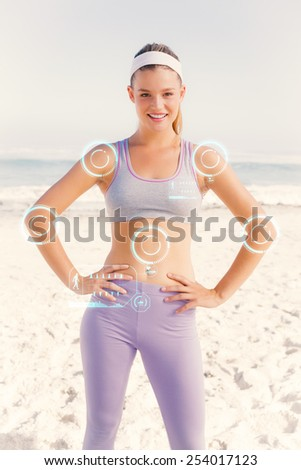 Sporty blonde on the beach smiling at camera against fitness interface - stock photo