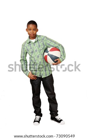 Sporty boy holding a game ball - stock photo