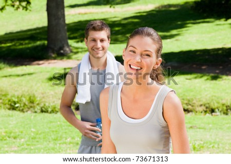 Sporty couple in the park - stock photo