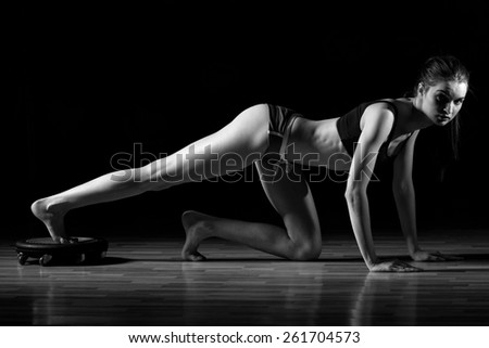 Sporty girl doing exercise with dumbbells in the gym. Attractive fitness woman, trained female body, lifestyle portrait, caucasian model.Pilates. - stock photo