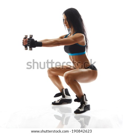 sporty girl doing exercise with dumbbells, silhouette back lit studio shot over white background - stock photo