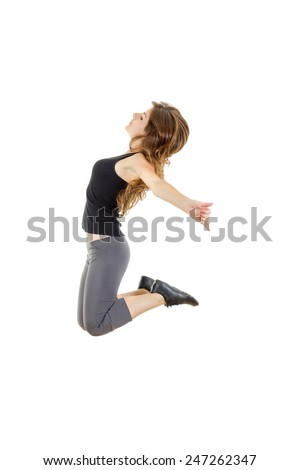 Sporty girl doing stretching exercises. slim hip-hop style teenage dancer dancing.  Weight loss fitness woman jumping of joy. Young sporty fit Caucasian female model isolated on white in full body - stock photo