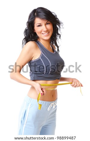 Sporty girl measuring her weist with tape, weight loss - stock photo