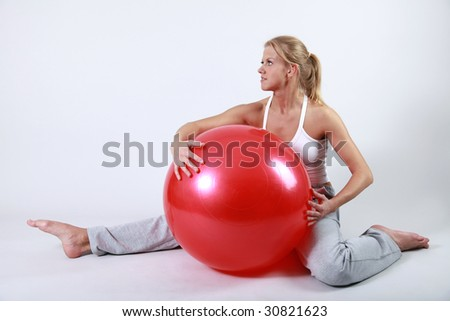 Sporty girl with a fitness ball - stock photo