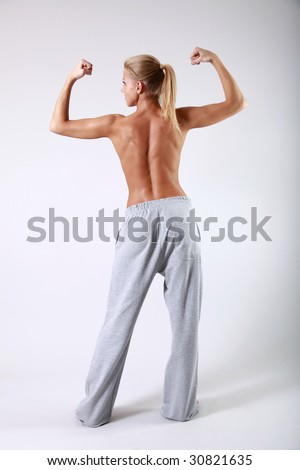 Sporty girl with muscles - stock photo