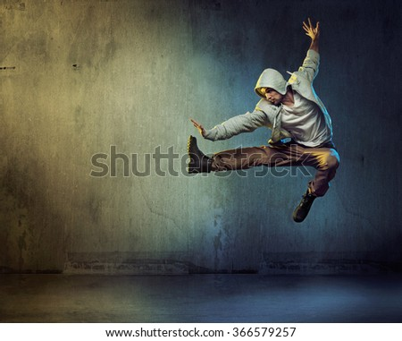 Sporty hip-hop dancer jumping - stock photo