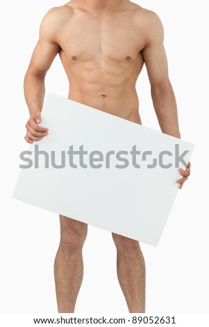 Sporty male body holding banner against a white background - stock photo