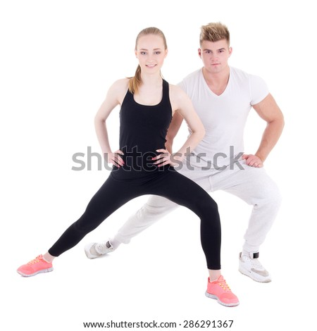 sporty man and woman stretching isolated on white background - stock photo