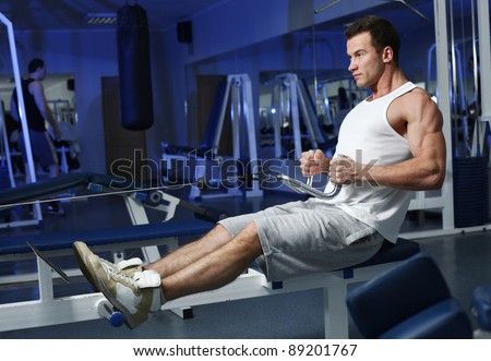 Sporty man in the gym - stock photo