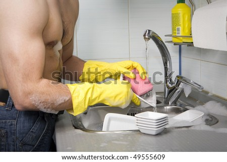 Sporty Man Washing Dish - stock photo
