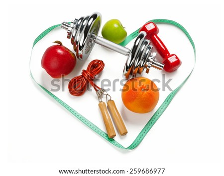 Sporty still life. Heart shape arrangement / photo of weight training and fitness equipment on white background  - stock photo