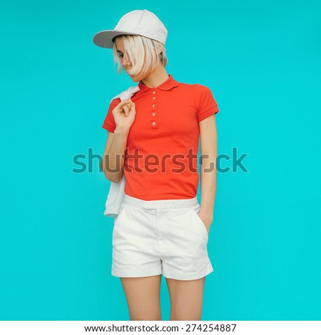 Sporty style. Girl in fashionable Clothes and Accessories - stock photo