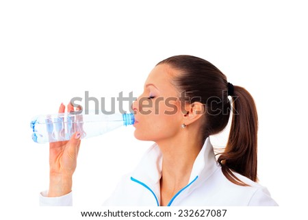 sporty woman drinking water, isolated against white background - stock photo