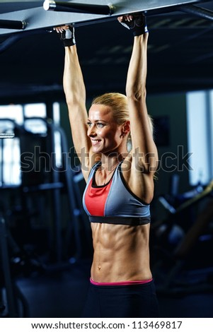sporty woman in gym - stock photo