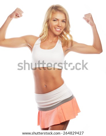 sporty woman is showing her strong hands on white background - stock photo