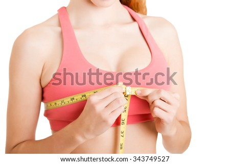 Sporty woman measuring up her chest, isolated in white - stock photo
