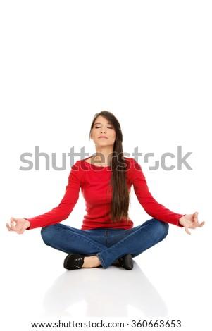 Sporty woman practicing yoga lotus pose. - stock photo