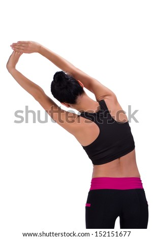 Sporty woman stretching her arms - stock photo