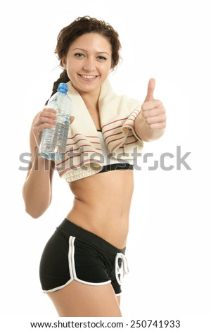 Sporty woman with bottle of water on white background - stock photo