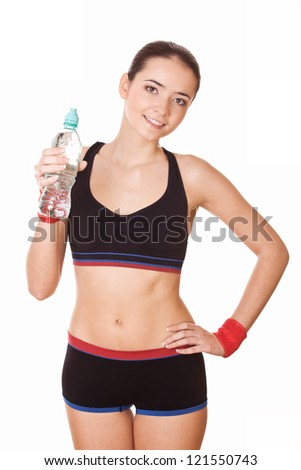 sporty woman with plastic bottle of water after fitness workout - stock photo
