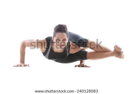 Sporty yoga girl on white background doing handstand push-ups - stock photo