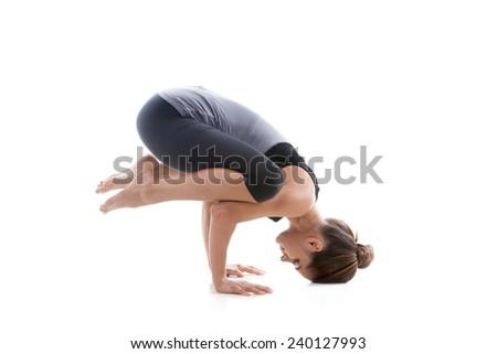 Sporty yoga girl on white background exercising - stock photo