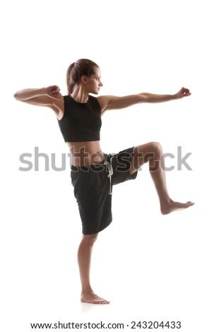 Sporty yoga girl on white background warming up - stock photo