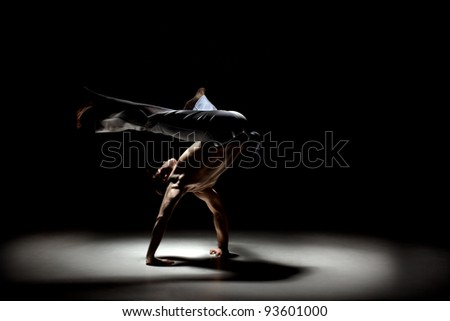 Sporty young capoeira man engaged gymnastic - stock photo