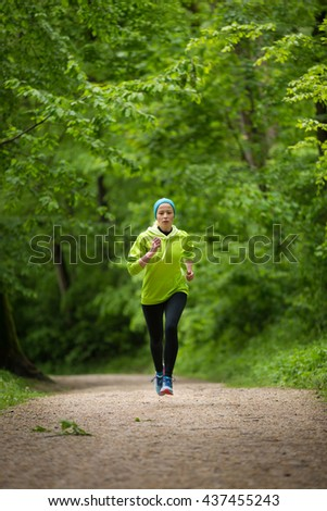 Sporty young female runner in forest.  Running woman. Female runner during outdoor workout in nature. Fitness model outdoors. Weight Loss. Healthy lifestyle.  - stock photo
