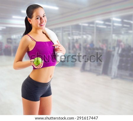 Sporty young girl at fitness club - stock photo