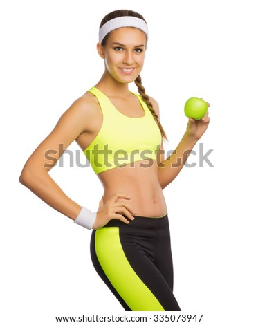 Sporty young girl with apple isolated - stock photo