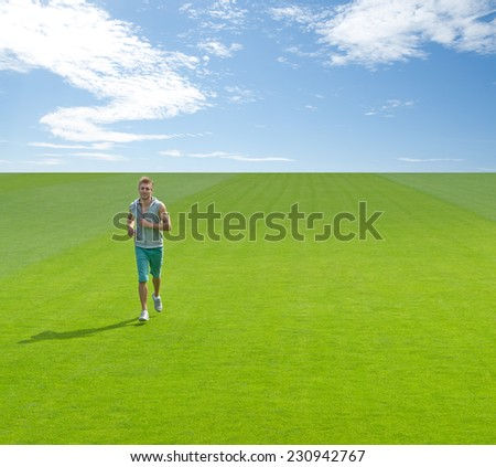 Sporty young man running on green field, under blue sky. - stock photo