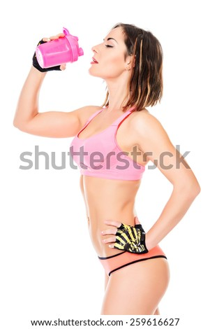 Sporty young woman drinking water after training. Active lifestyle, wellness. Isolated over white. - stock photo