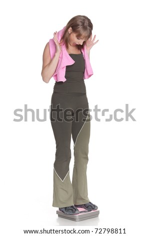 Sporty young woman with scales on a white background.  Concept of healthy lifestyle. - stock photo