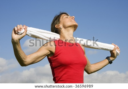 Sporty young women with towel enjoying the sun - stock photo