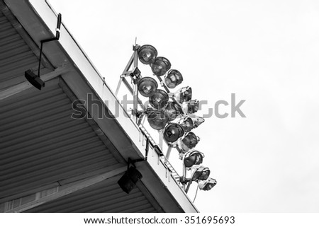 Spotlight on top of building  stadium , image of side  view in black and white style - stock photo