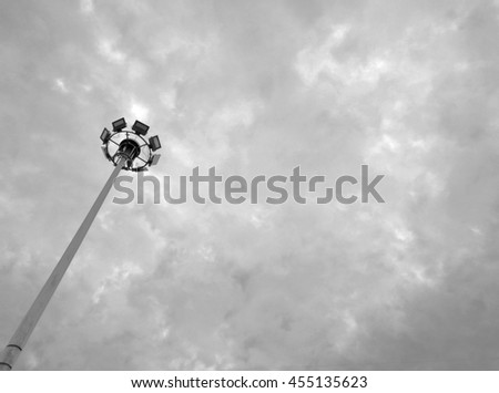 spotlight pillar on cloudy sky in the morning - monochrome style - stock photo