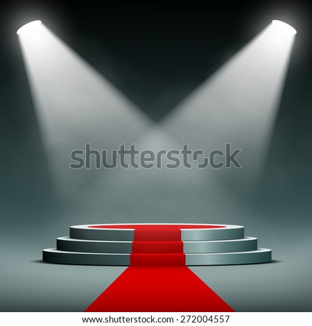 spotlights illuminate the pedestal with red carpet - stock photo