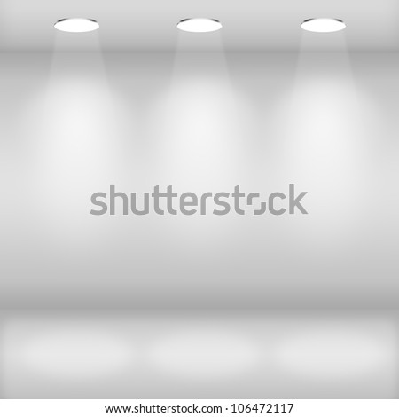 Spotlights in gallery interior with empty wall - stock photo